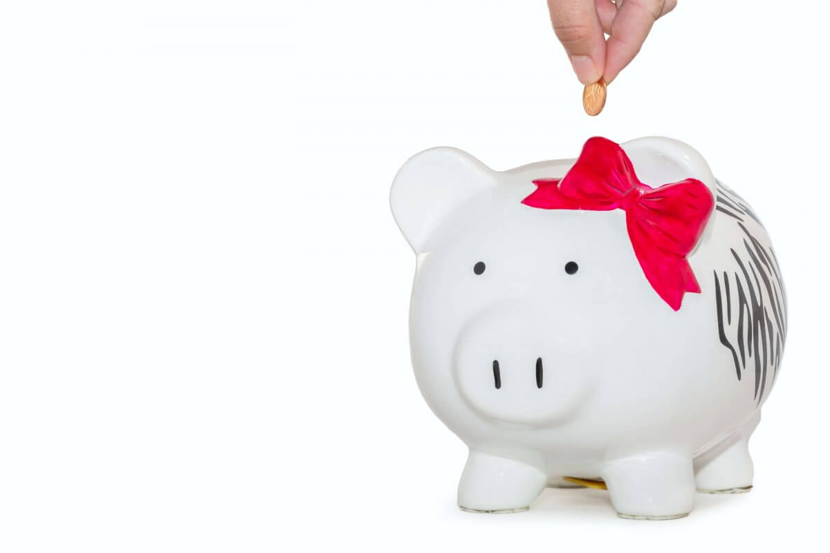 How To Create A Budget. Piggy Bank with pink bow